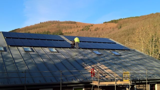 Finishing the solar installation at Knighton Community Centre